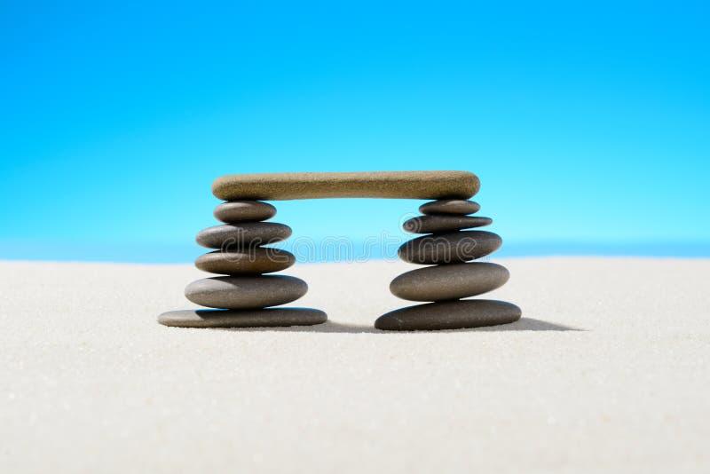 Zen stones on the sandy beach. F royalty free stock image