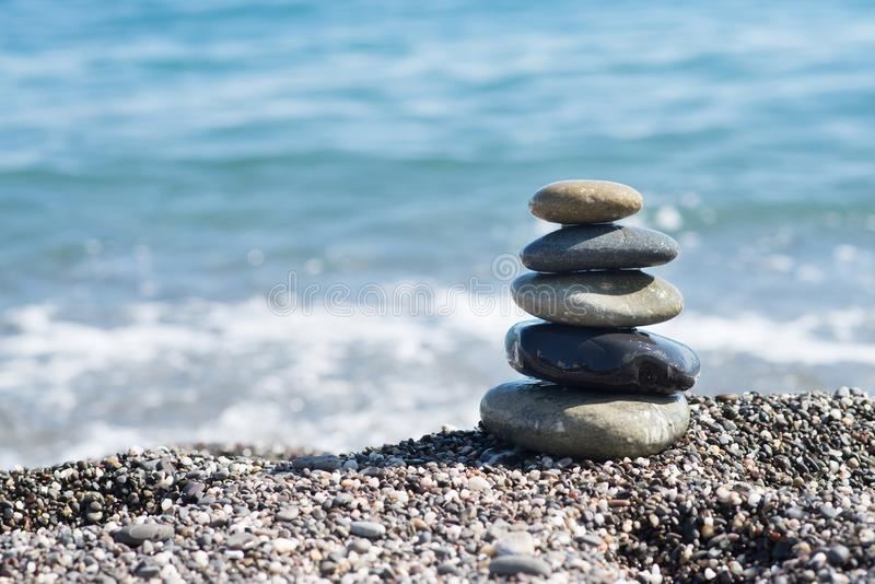 Zen stones on sea shore, symbol of buddhism stock images
