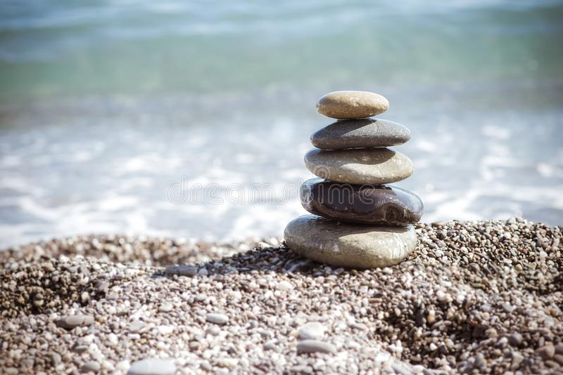 Zen stones on sea shore, symbol of buddhism stock photo