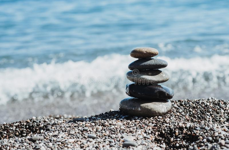 Zen stones on sea shore, symbol of buddhism stock image