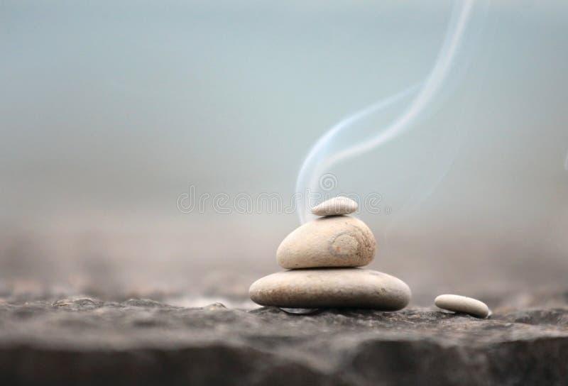 Zen stones with smoke stock image