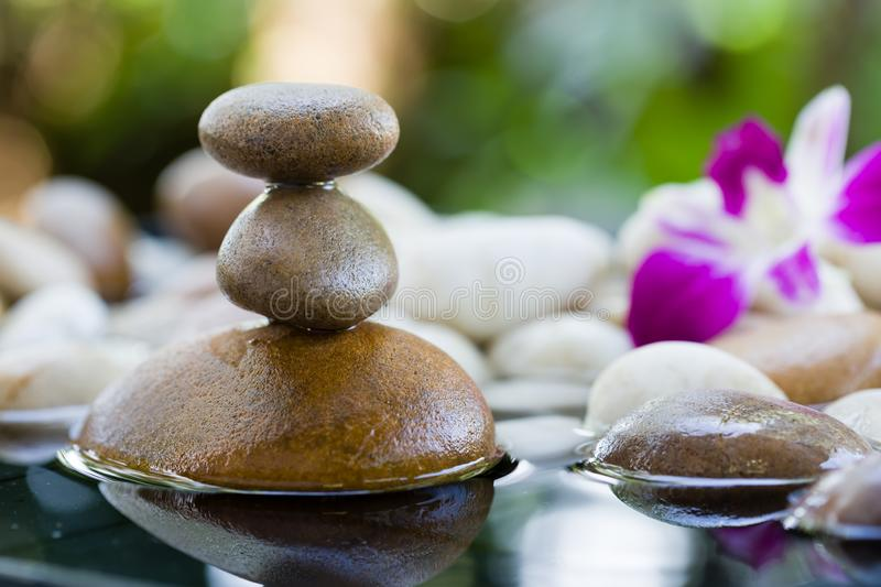 Zen Stones stacked with water reflection. On the nature background, Zen rocks for meditation stock photography