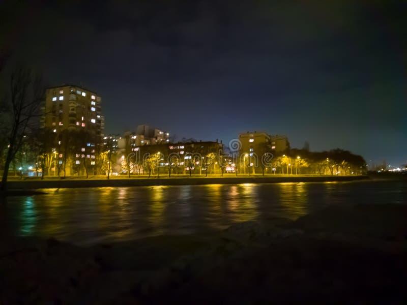 Zenica and Bosnia River. Night view across the Bosnia River to the city of Zenica along the river's edge stock photos