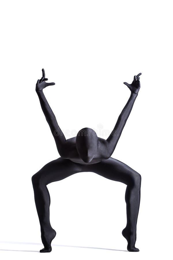 Zentai suit. Silhouette of a human in black zentai suit stock image