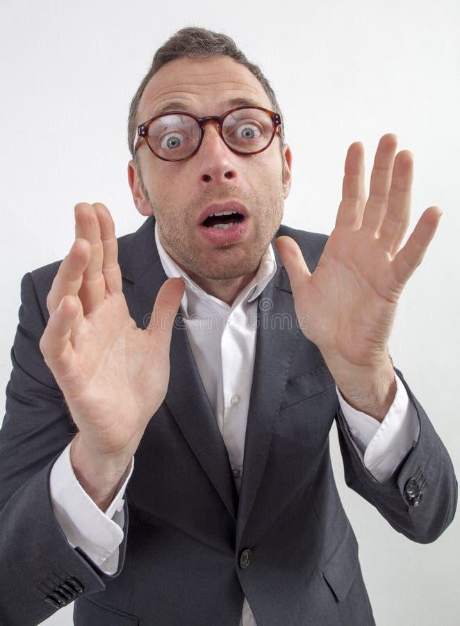 Zenuwachtige manager die gevaar of fobie met humeur en vrees uitdrukken royalty-vrije stock afbeelding