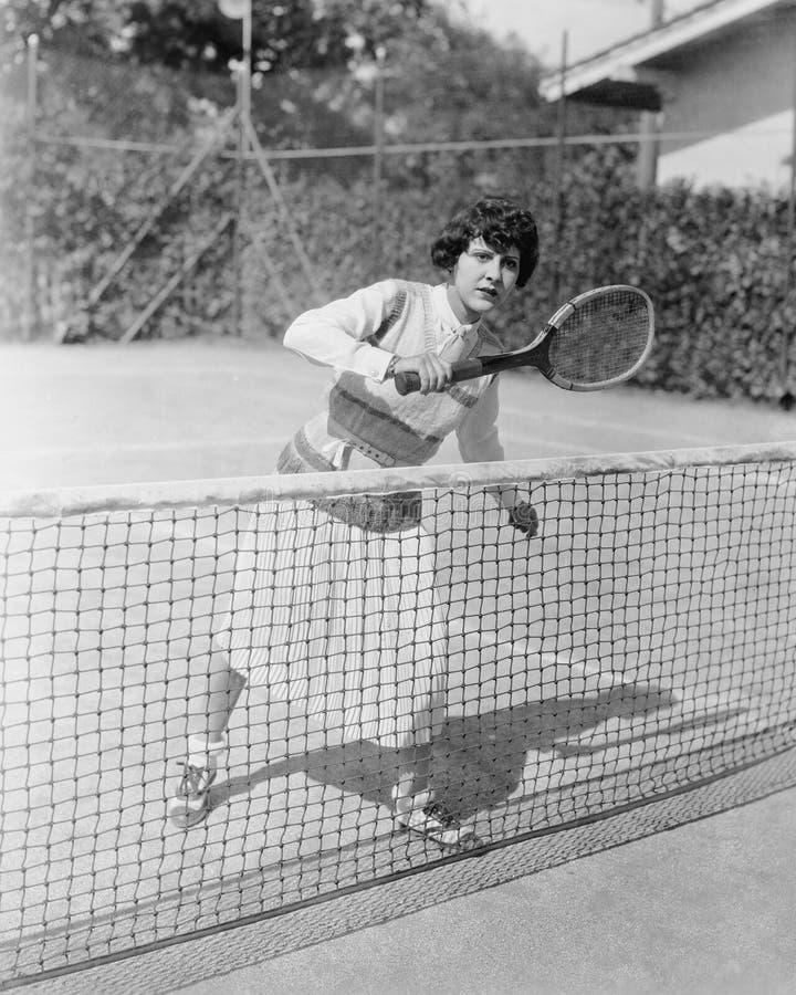 Zenuwachtige vrouwelijke tennisspeler (Alle afgeschilderde personen leven niet langer en geen landgoed bestaat Leveranciersgarant royalty-vrije stock afbeelding