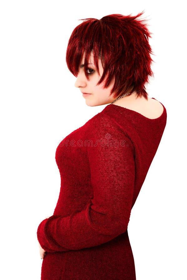 Zenzero teenager nel colore rosso fotografia stock