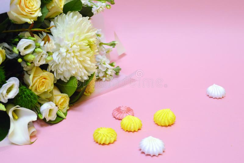 Zephyr and flowers on a pink background with copy space. royalty free stock image