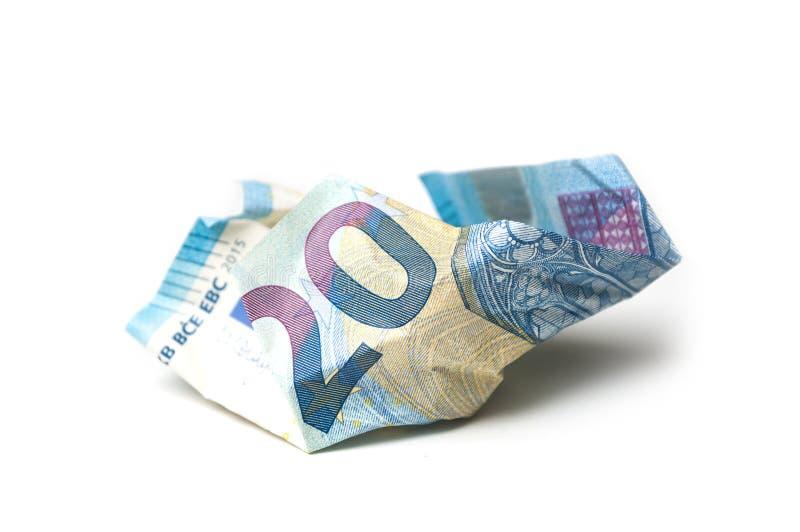 Zerknitterte zwanzig-Euro-Banknote auf weißem Hintergrund lizenzfreies stockbild