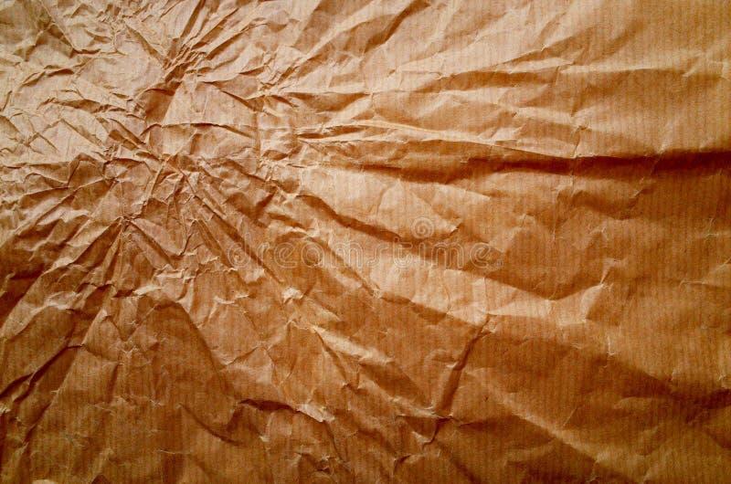 Zerknitterter Packpapierhintergrund mit Bullauge und Schatten lizenzfreie stockbilder