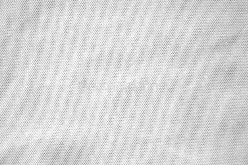 Zerknitterter weißer Gewebebeschaffenheitshintergrund stockbild