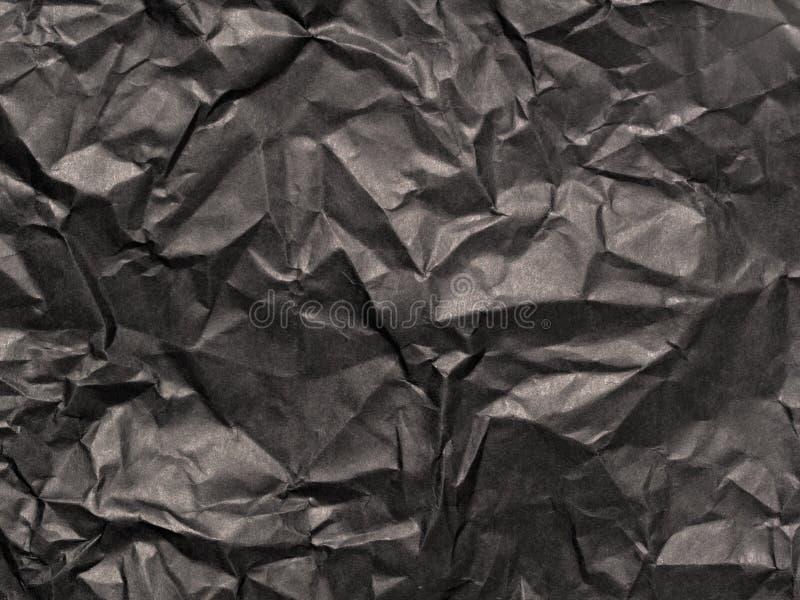 Zerknittertes schwarzes Papier stockbilder
