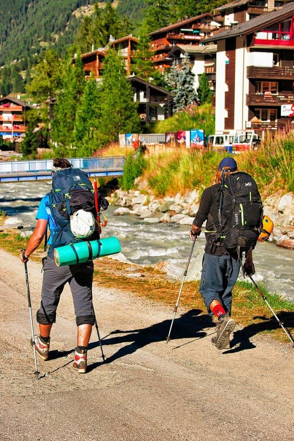 Zermatt, Switzerland - August 24, 2016: People doing nordic walking in resort city Zermatt in Switzerland in summer stock images