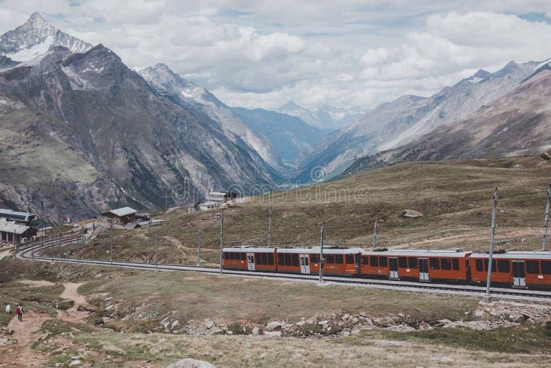 Gornergrat train with tourist is going to Matterhorn mountain stock photo