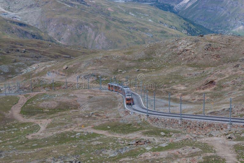 Gornergrat train with tourist is going to Matterhorn mountain royalty free stock photos