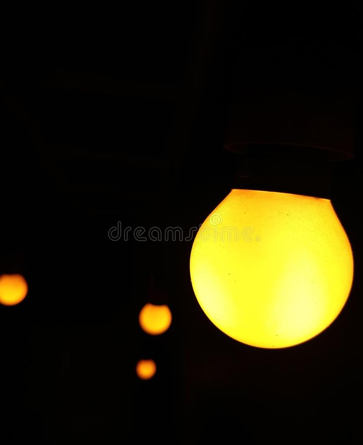 Zero electric yellow bulb used cafe Interior  low light photography royalty free stock photo