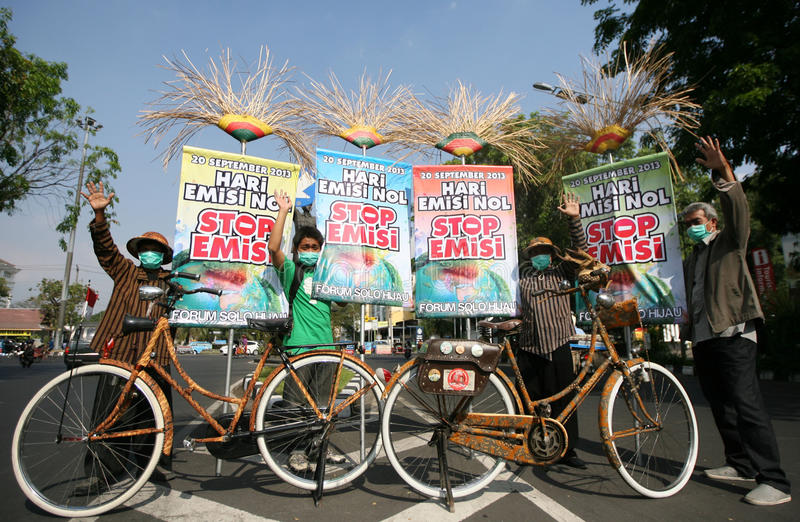 Zero emission. Residents protested the day commemorating zero emissions in the city of Solo, Central Java, Indonesia stock images