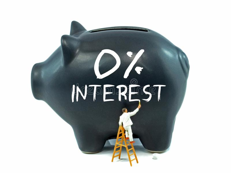 Zero Percent Interest on Piggy Bank. A piggy bank with zero percent interest theme painted on the side royalty free stock images
