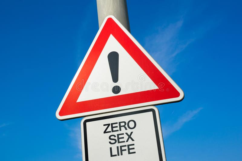 Zero sex life. Traffic sign with exclamation mark to alert, warn caution - problem and trouble because of absence and lack of sexual intercourse leading to royalty free stock photography