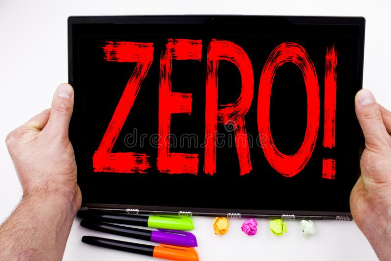 Zero text written on tablet, computer in the office with marker, pen, stationery. Business concept for Zero Zeros Nought Tolerance. White background with space royalty free stock photo