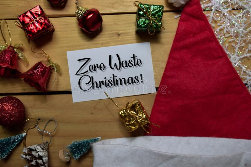 Zero Waste Christmas write on white paper with wooden backgroud. Frame of Christmas Decoration royalty free stock images