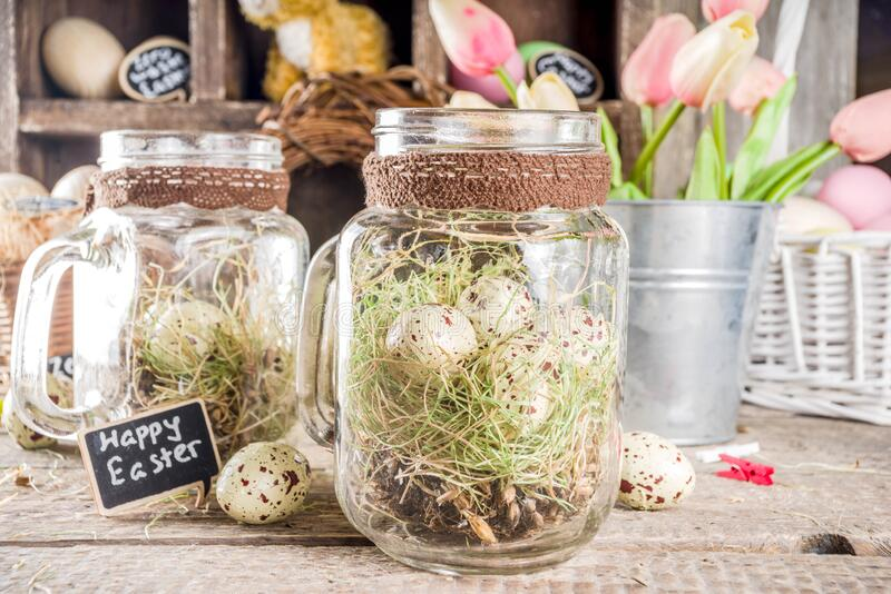 Zero waste Easter concept. Spring Easter holiday. background. Zero waste Easter concept with traditional Easter decoration - eggs, flowers, branches, bunny. Eco stock photo