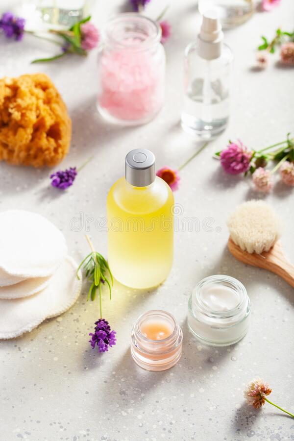 Zero waste eco friendly bath and body care products and wild flowers. natural cosmetics for home spa treatment stock photos