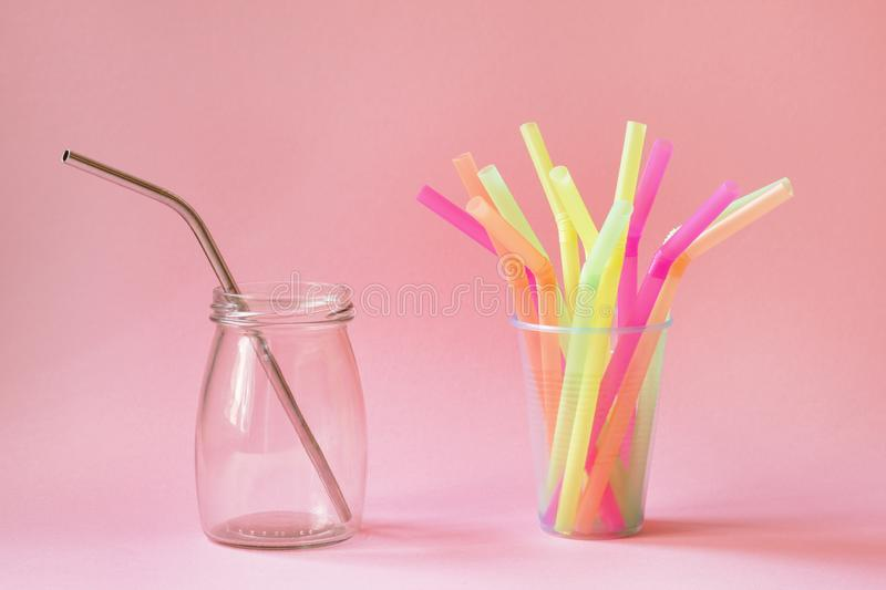 Choice between reusable metal straw and plastic straws. Zero waste and eco-friendly green lifestyle concept, choice between reusable metal straw and plastic royalty free stock photos
