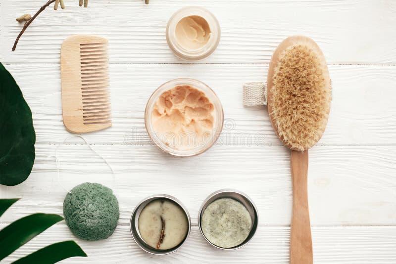 Zero waste flat lay. Natural solid shampoo, wooden brush, deodo stock photos
