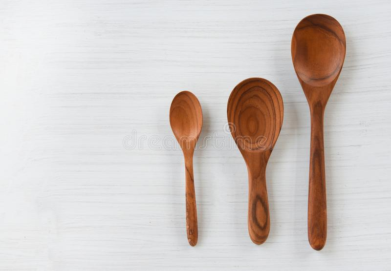 Zero waste kitchen use less plastic concept / Various sizes of wooden spoon and wooden cooked rice ladle. On white background royalty free stock images