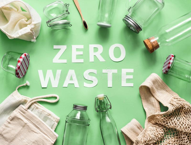 Zero waste paper text and eco bags, glass jars stock photos