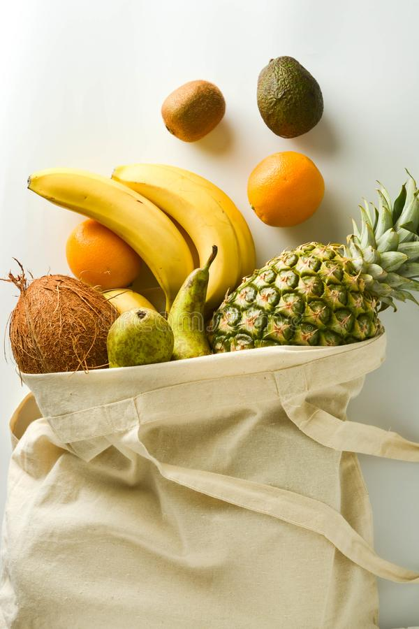 Zero waste and plastic free concept. Grocery shopping with eco bag over white background. Flat lay, top view. Copy space. Zero waste and plastic free concept royalty free stock photos