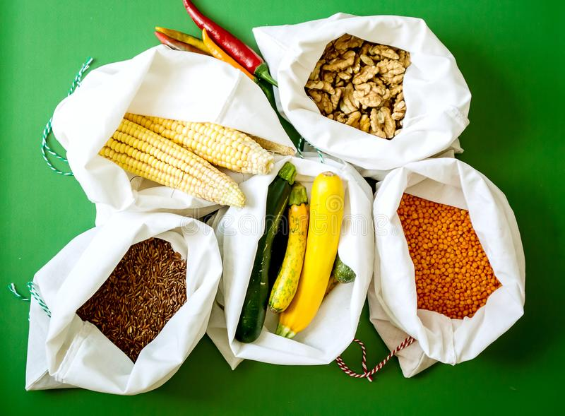 Zero waste shopping. Concept. Cotton bag full of vegatables on yellow background. bying product with out package stock image