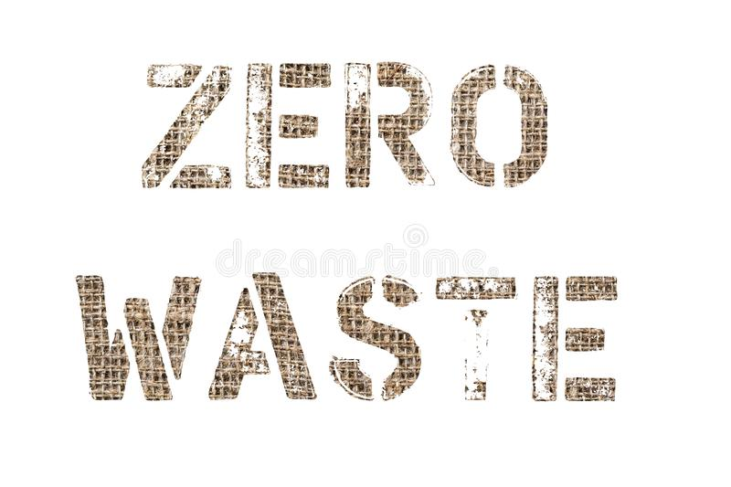 Zero waste. Text cut of old textile background photo, the inscription on white royalty free stock photo