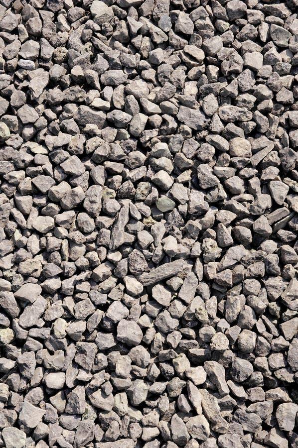 Zerquetschte Stein-, braune Kiesnahaufnahme stockfotografie