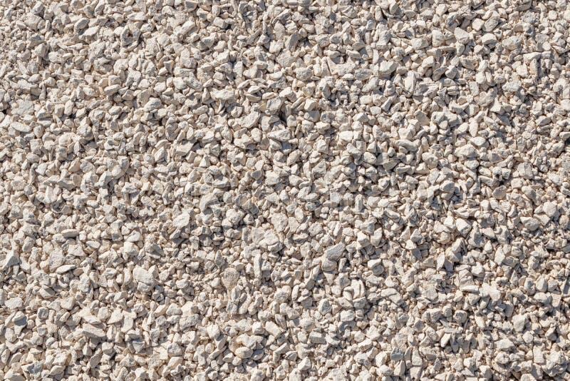 Zerquetschter Steinhintergrund von Kalksteinfelsen Stra?enkies natürliche Kiesbeschaffenheit, Kieskieshintergrund lizenzfreie stockfotografie