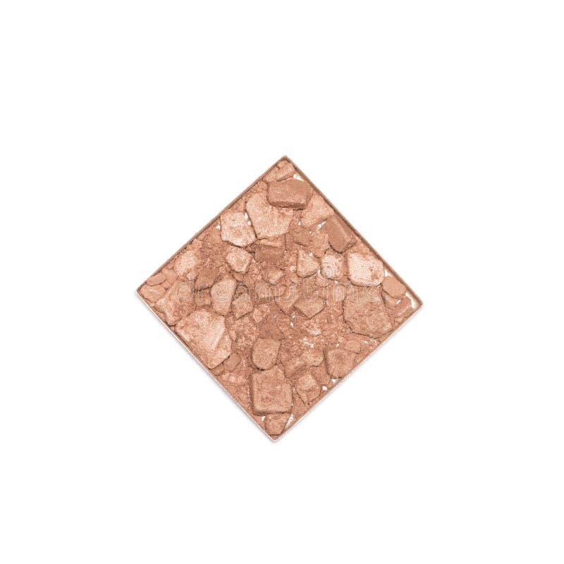 Zerquetschter Vertrag, der den Gesichtspuder lokalisiert auf Weiß bronziert lizenzfreies stockfoto