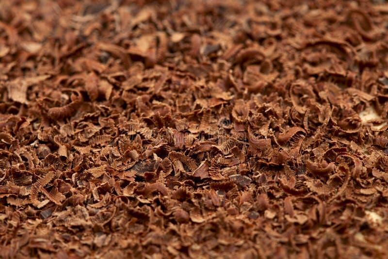 Zerrieben 100 Prozent dunkle Schokoladenhintergrund der Kakaos stockbilder
