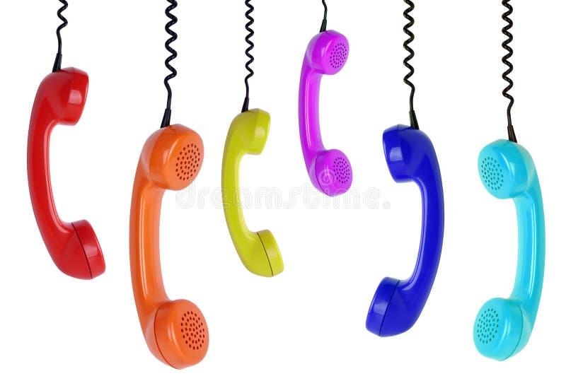 Zes het gekleurde telefoons hangen royalty-vrije stock afbeelding