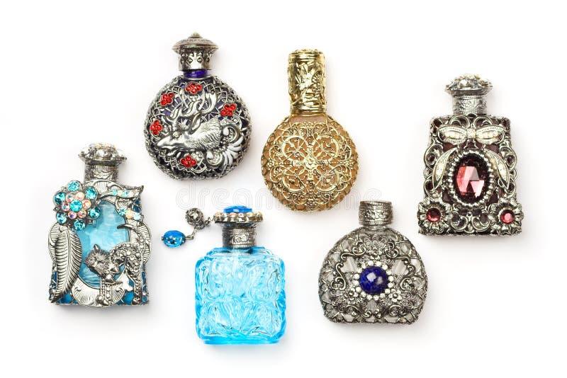 Zes parfumflessen stock fotografie
