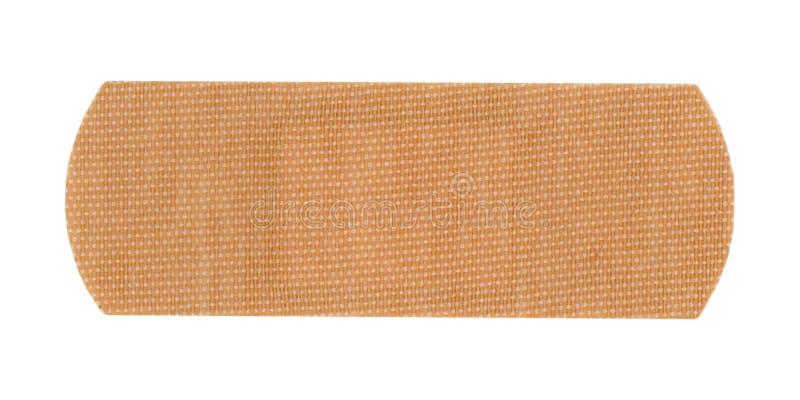 zespół pomocy bandaż odizolowywający nad bielem fotografia stock