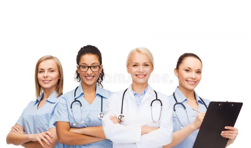 Zespala się lub grupa kobiet pielęgniarki i lekarki fotografia stock