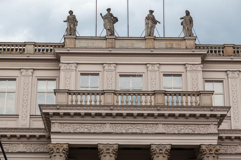 Zeughaus Historical Building Berlin. The facade of the Zeughaus historical building with statues with trumpets on charriots, Berlin, Germany royalty free stock image