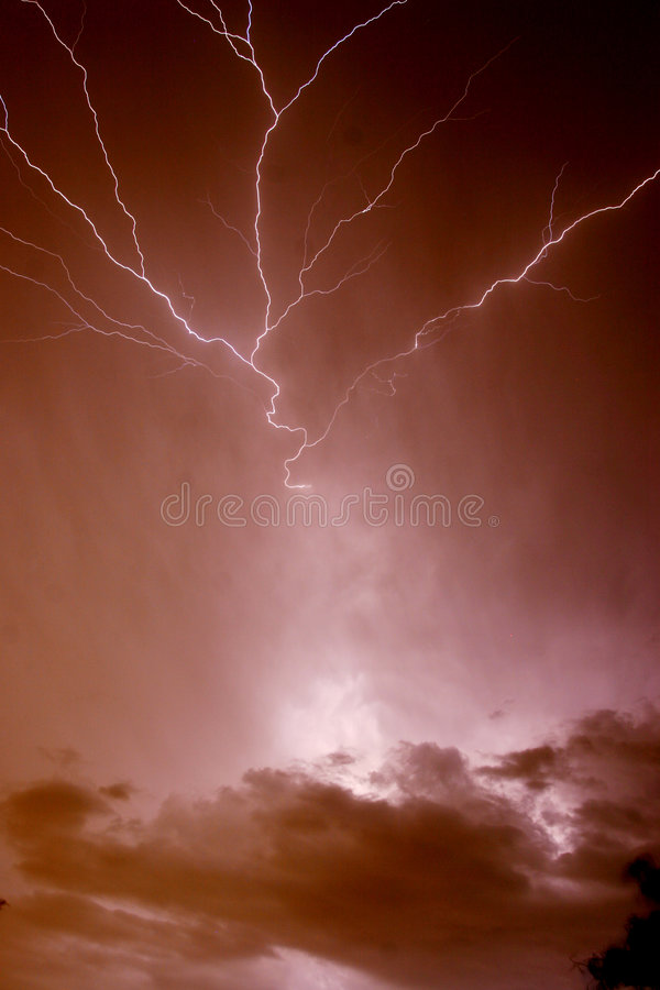 ZEUS' FURY. MULTI BRANCHED LIGHTNING BOLT FROM LAYERED CLOUDS stock photos