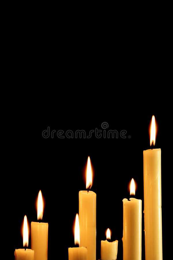 Zeven brandende kaarsen stock afbeeldingen