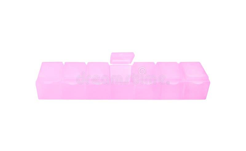 Zevendaagse pillen lichtrose plastic die doos op witte achtergrond met het knippen van weg wordt geïsoleerd royalty-vrije stock foto's
