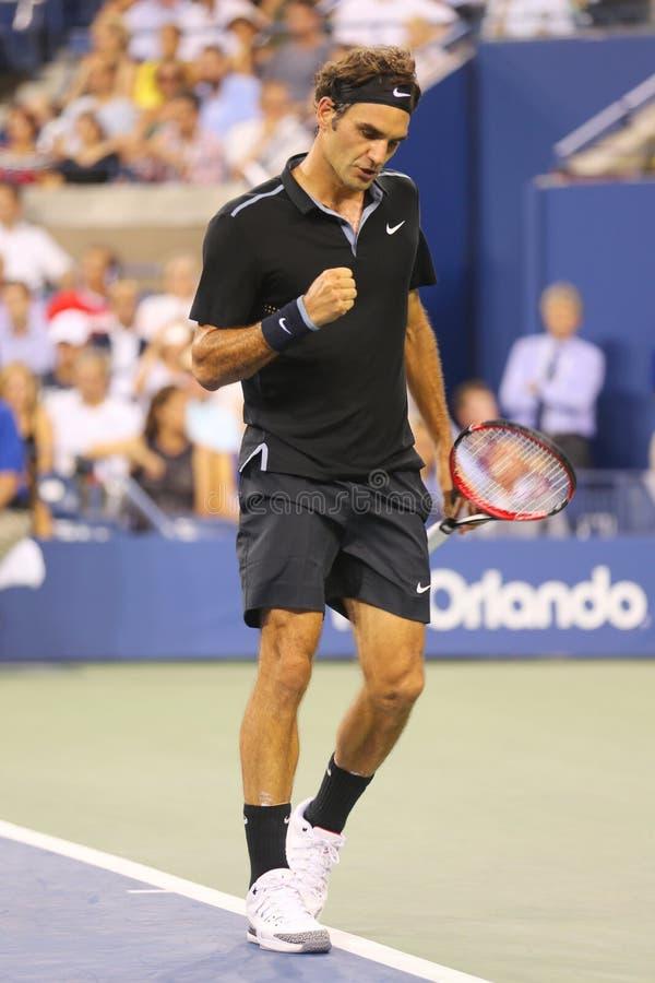 Zeventien keer Grote Slagkampioen Roger Federer tijdens ronde gelijke 4 bij US Open 2014 stock fotografie
