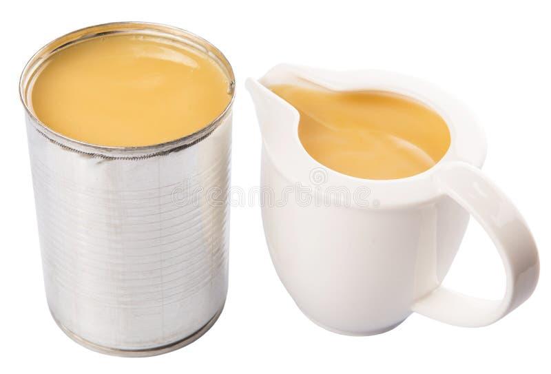 Zgęszczony mleko W Blaszanej puszki I mleka zbiorniku Ja fotografia stock