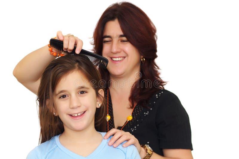 zgrzywionej córki włosiana latin matka s mała fotografia stock