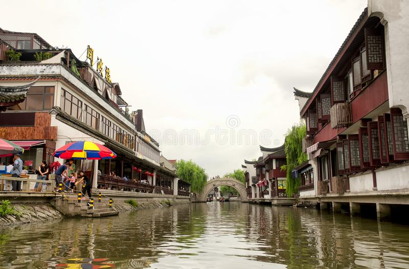 Zhaojialou Water Town Shanghai China. Tourist boats on the old yaojiabang river and the water canals of Zhaojialou in Shanghai China on an overcast day stock images